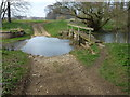 TF0321 : Ford and footbridge near Grimsthorpe Castle by Richard Humphrey