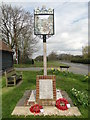 TL8358 : Whepstead War Memorial and village sign by Adrian S Pye