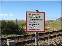 SH6214 : West to Fairbourne bilingual warning-Morfa Mawddach, Gwynedd by Martin Richard Phelan
