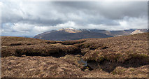 NN1522 : Peat haggs and banks near to trig point of Bealach nan Cabrach by Trevor Littlewood