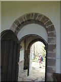 SS8403 : Norman arch and porch of St Mary's church, Upton Hellions by David Smith