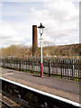 SD7916 : Lamp Standard and Disused Chimney, Ramsbottom Station by David Dixon