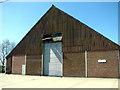TG0526 : Unusual farm shed by Evelyn Simak