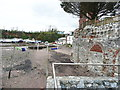 SX9884 : Blocked arches of lime-kilns, Lympstone by Humphrey Bolton