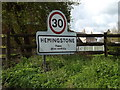 TM1553 : Hemingstone Village Name sign on Main Road by Adrian Cable