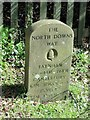TQ4256 : The North Downs Way milestone by the Kent/Surrey border by Dave Kelly