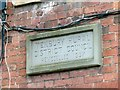 SO5968 : Datestone on the old workhouse by Alan Murray-Rust
