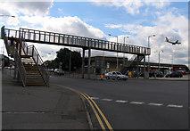 TQ0975 : Footbridge across Hatton Road South by Andrew Tatlow