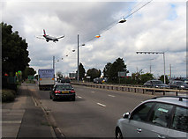 TQ0975 : Great South-west Road passes BP Hatton Cross by Andrew Tatlow