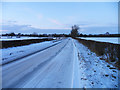 SK6515 : Snow covered Rearsby Road towards Thrussington by Andrew Tatlow