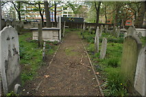 TQ3282 : View of a path through the graves in Bunhill Fields by Robert Lamb