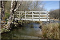 SH7711 : Footbridge over Nant Ceiswyn by Michael Graham
