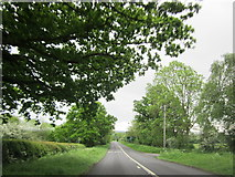 SP0858 : B4090 Approaching A436 Island Alcester by Roy Hughes