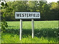 TM1847 : Westerfield Village Name sign on Church lane by Adrian Cable