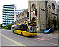 SZ0891 : Yellow bus descends Exeter Road, Bournemouth by Jaggery