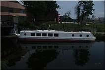 TQ3784 : View of a boat reflected in the River Lea from the River Lea Navigation #2 by Robert Lamb