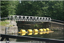 TQ3783 : View of a footbridge and row of buoys on the River Lea from the Plough Cafe by Robert Lamb