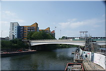 TQ3882 : View of the Twelvetrees Crescent bridge from the raised pathway at the confluence of the River Lea and Limehouse Cut by Robert Lamb