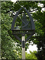 TL9759 : Rattlesden Village sign by Adrian Cable
