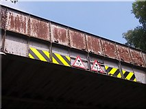 SE2334 : Pigeons roosting on a disused bridge by Stephen Craven