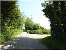 TM0949 : Nettlestead Road & footpath by Adrian Cable