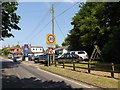 TM0948 : Somersham Garage & Somersham Village Name sign by Adrian Cable