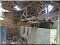TG2712 : Inside a derelict farm building at Hall Farm by Adrian S Pye