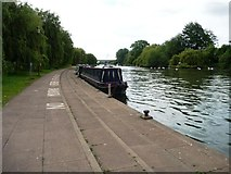 TL1998 : Moored boats on the River Nene, Peterborough by Christine Johnstone