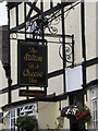 TL1689 : The Stilton Cheese Inn Public House sign by Adrian Cable