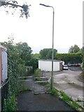 SZ0795 : East Howe: footpath U38 passes some garages by Chris Downer