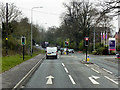 SJ6072 : Warrington Road, Traffic Lights at Eden Grange by David Dixon