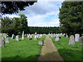 TL3097 : Holy Trinity, Coates: churchyard (II) by Basher Eyre