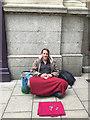 TL1998 : Begging in Bridge Street, Peterborough by Robin Stott