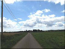 TM1678 : Footpath to the A143 Bungay Road & entrance of Hall Farm by Adrian Cable