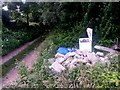 SZ0895 : Redhill: fly tipping alongside Sandy Way by Chris Downer