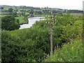 NY5636 : River Eden & railway-side telegraph pole by Andrew Curtis