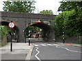 TQ3195 : Railway bridge, Grange Park by Paul Bryan