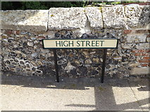 TL9979 : High Street sign by Adrian Cable