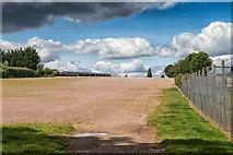 SO9524 : Footpath crosses a car park area by David P Howard