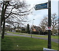 SO9222 : Cycle route direction sign on a Cheltenham corner by Jaggery