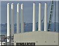 J3677 : Wind turbine masts, Belfast harbour - July 2016(3) by Albert Bridge
