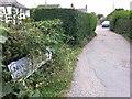 SZ0694 : Wallisdown: sign for concealed houses on footpath U16 by Chris Downer