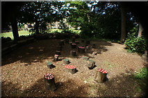 TQ1572 : View of toadstool seats in a children's story time area in the woodland at the back of Strawberry Hill House by Robert Lamb