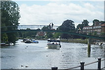TQ1673 : View of Merrie Thames passing under the footbridge to Eel Pie Island from The Embankment by Robert Lamb