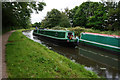 SK4741 : Canal boat Little Owl passes Movin On by Ian S