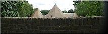TQ1673 : View of marquees in the back garden of a house on the Riverside by Robert Lamb