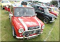 TQ5583 : View of a row of Minis in Havering Mind's Wings and Wheels event at Damyns Hall Aerodrome #2 by Robert Lamb