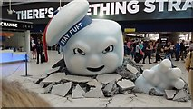 TQ3179 : View of the Stay Puft Marshmallow Man from Ghostbusters artwork in Waterloo Station concourse by Robert Lamb