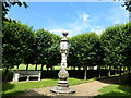 TF7928 : Sundial and pleached lime trees at Houghton Hall by Richard Humphrey