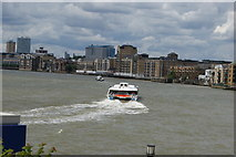 TQ3680 : View of a Thames Clipper leaving Canary Wharf Pier from Canary Riverside by Robert Lamb